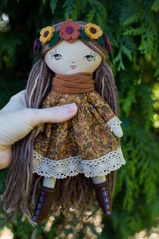 handmade cloth doll in autumn floral dress and flower headband