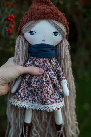 handmade cloth doll wearing Liberty of London dress and popcorn pixie hat