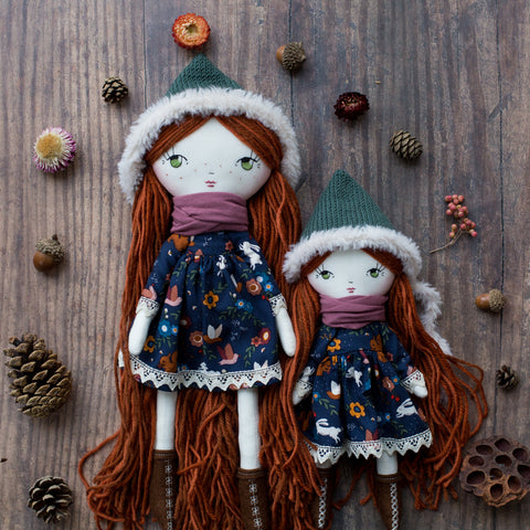 handmade cloth dolls wearing forest dress and fur pixie bonnet