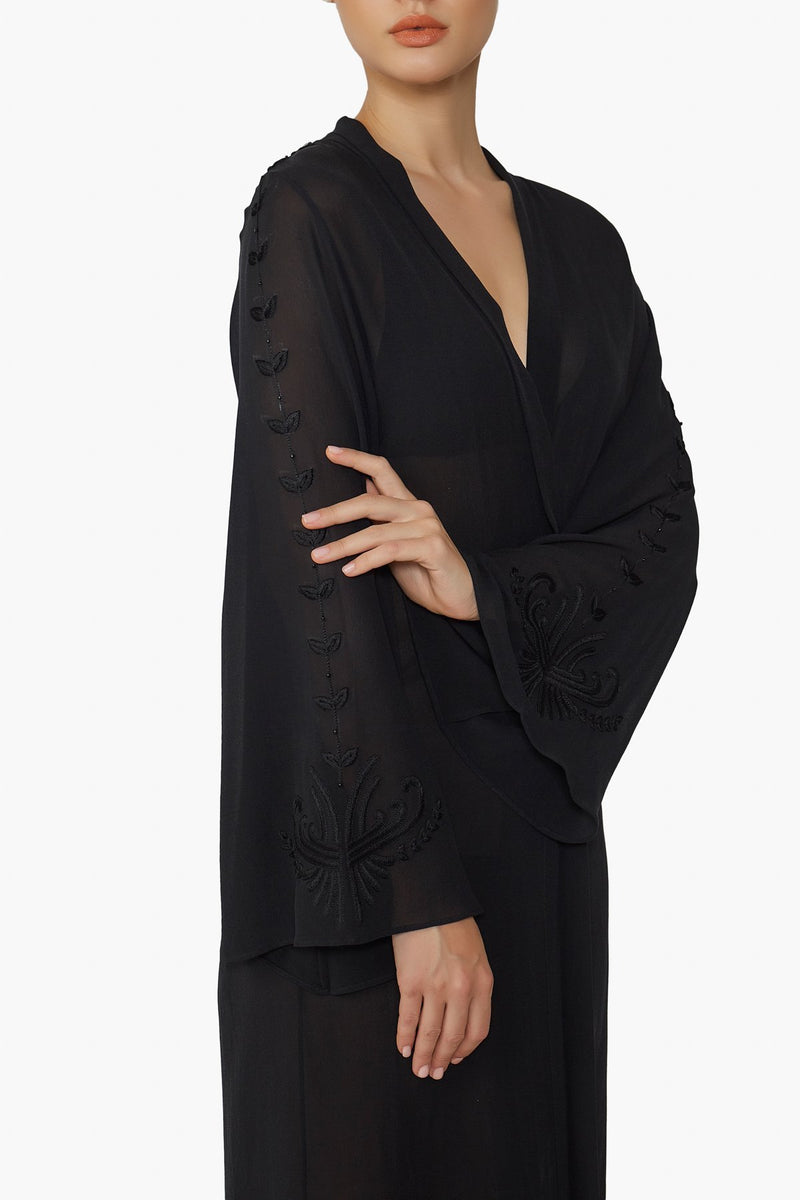 model wearing Luxurious Designer Silk Georgette Black Kimono Cape Duster Cover Up with hand embroidered details perfect for luxury resort wear and beach club