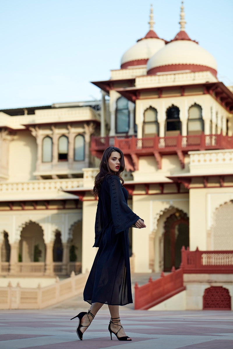 model wearing Luxurious Designer Silk Georgette Black Kimono Cape Duster Cover Up with hand embroidered details perfect for luxury resort wear and yacht beach club