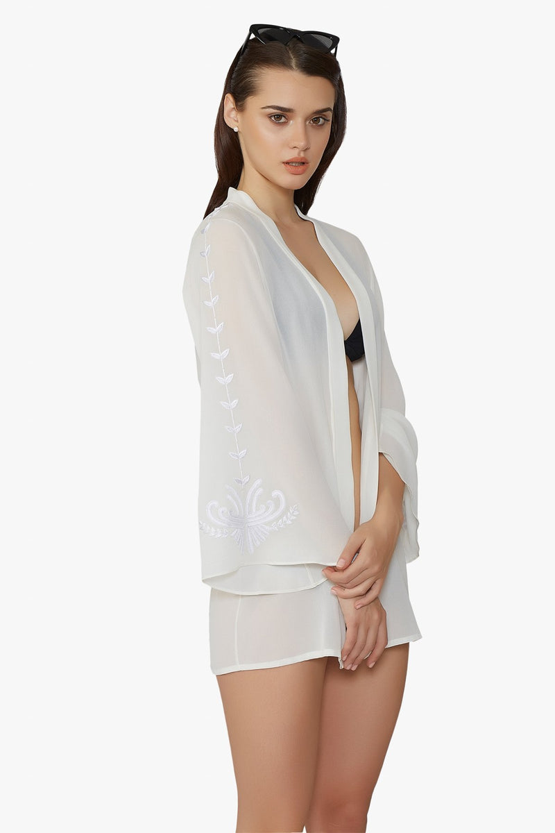 Luxurious Designer Silk Georgette Ivory White Kimono Cape Duster Cover Up with hand embroidered details perfect for luxury honeymoon resort wear and beach club