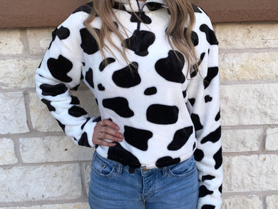 BLACK AND WHITE COW PRINT HALF ZIP