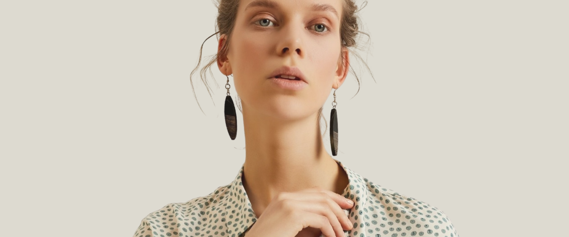 Model wearing large statement earrings