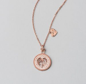 925 sterling silver, rose gold plated necklace with heart shaped pendant decorated with white zirconia stones.