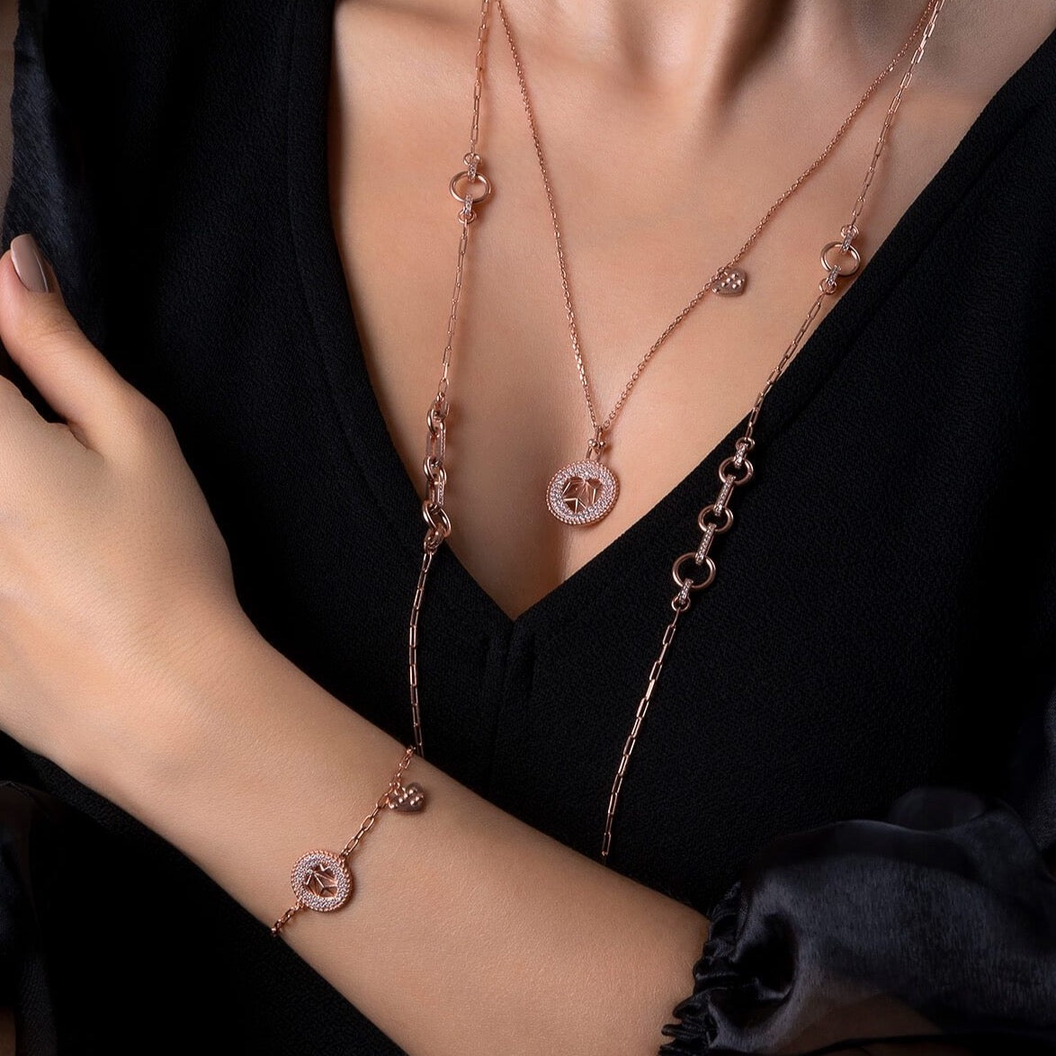Photo of 925 sterling silver, rose gold plated necklace on a model.