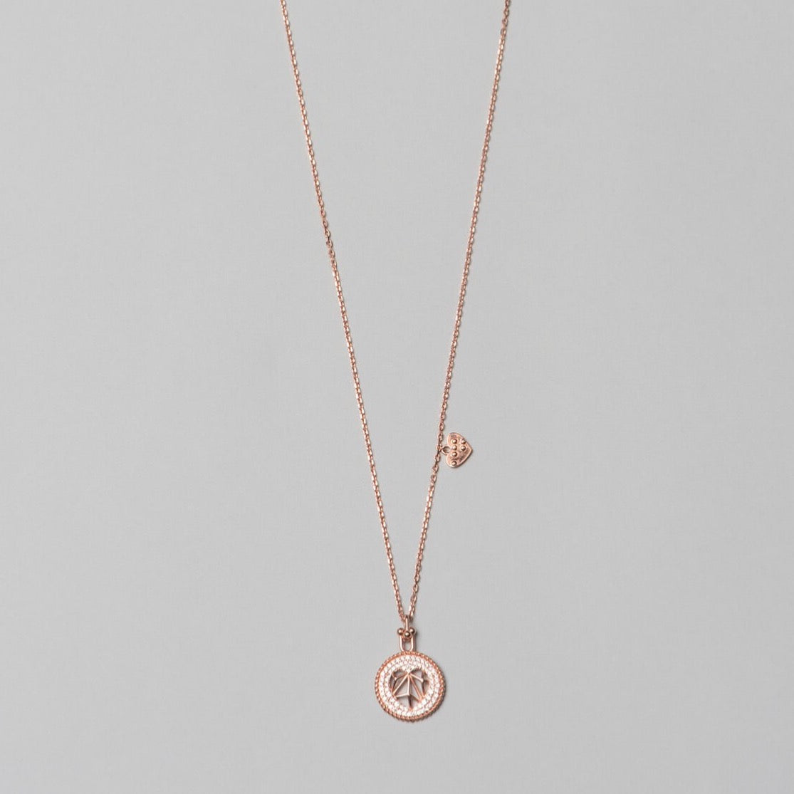 Photo of 925 sterling silver, rose gold plated necklace with white heart shape pendant, complete look.