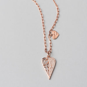 Rose gold plated, 925 sterling silver  necklace with heart pendant. Half of the pendant is decorated with white zirconia stones.