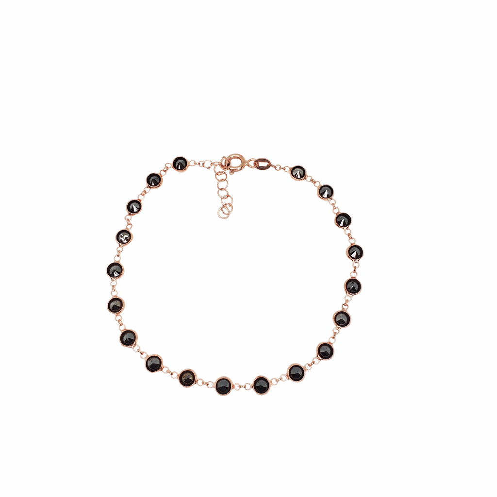 Rose gold silver bracelet with black zirconia beads.