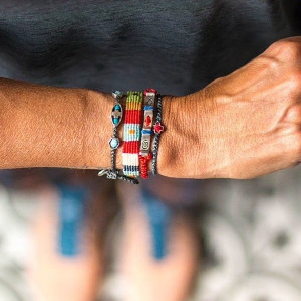 Faith bracelet on wrist combined with other bracelets