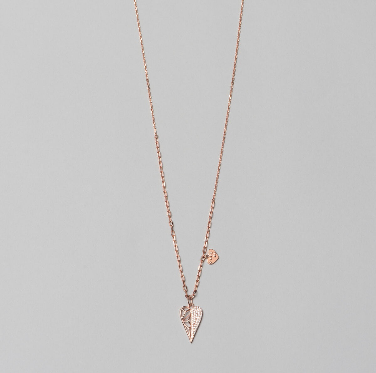 Rose gold plated, 925 sterling silver  necklace with heart pendant. Half of the pendant is decorated with white zirconia stones, complete look.