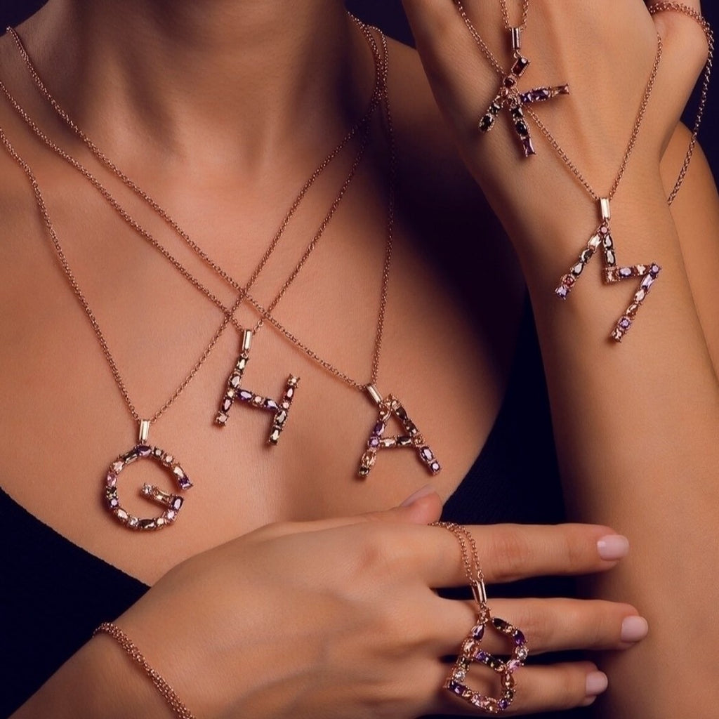 925 sterling silver, rose gold plated letter pendant necklaces on a model.