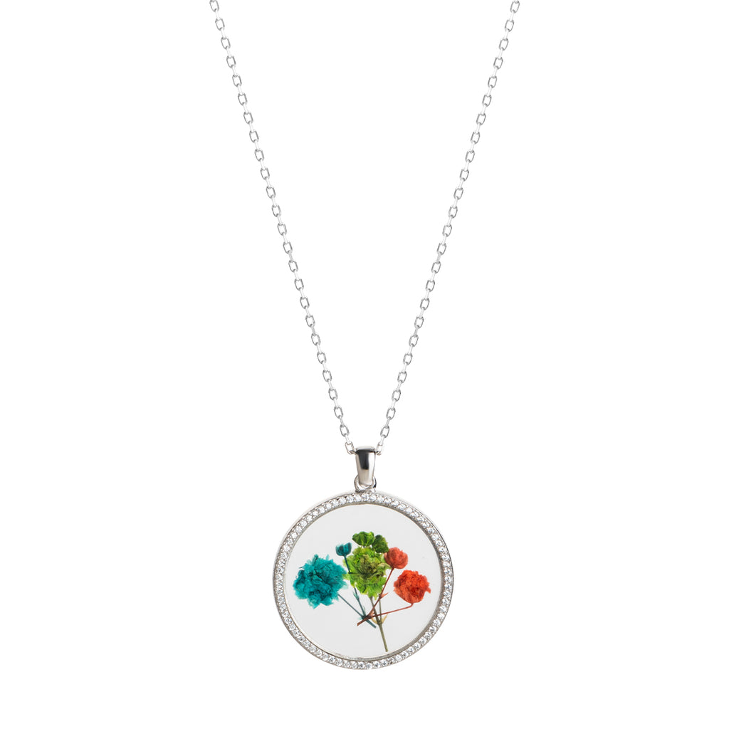925 Sterling silver necklace with circle  glass pendant with dried flowers in it.