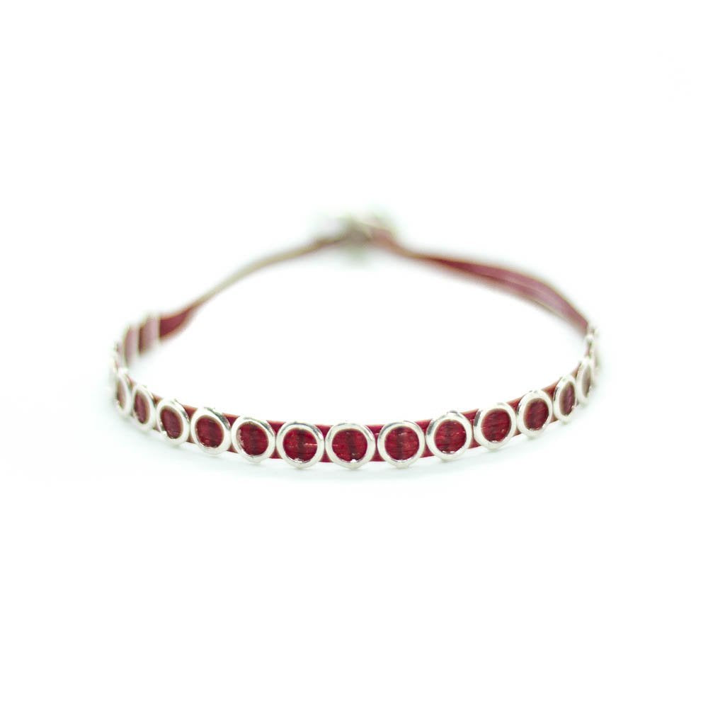 Custom design red string bracelet with  silver circle void beads.