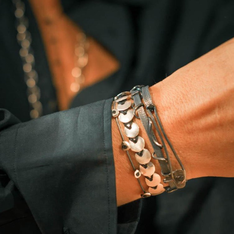 Custom design, silver, hand made bracelet with herringbone pattern silver beads on wrist.