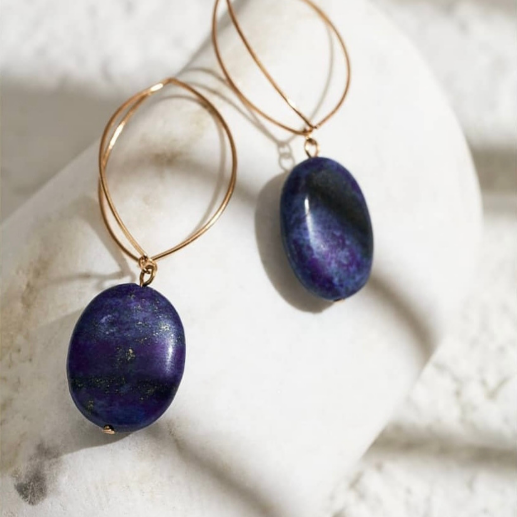 Navy blue natural stone earrings photo on a white stone.