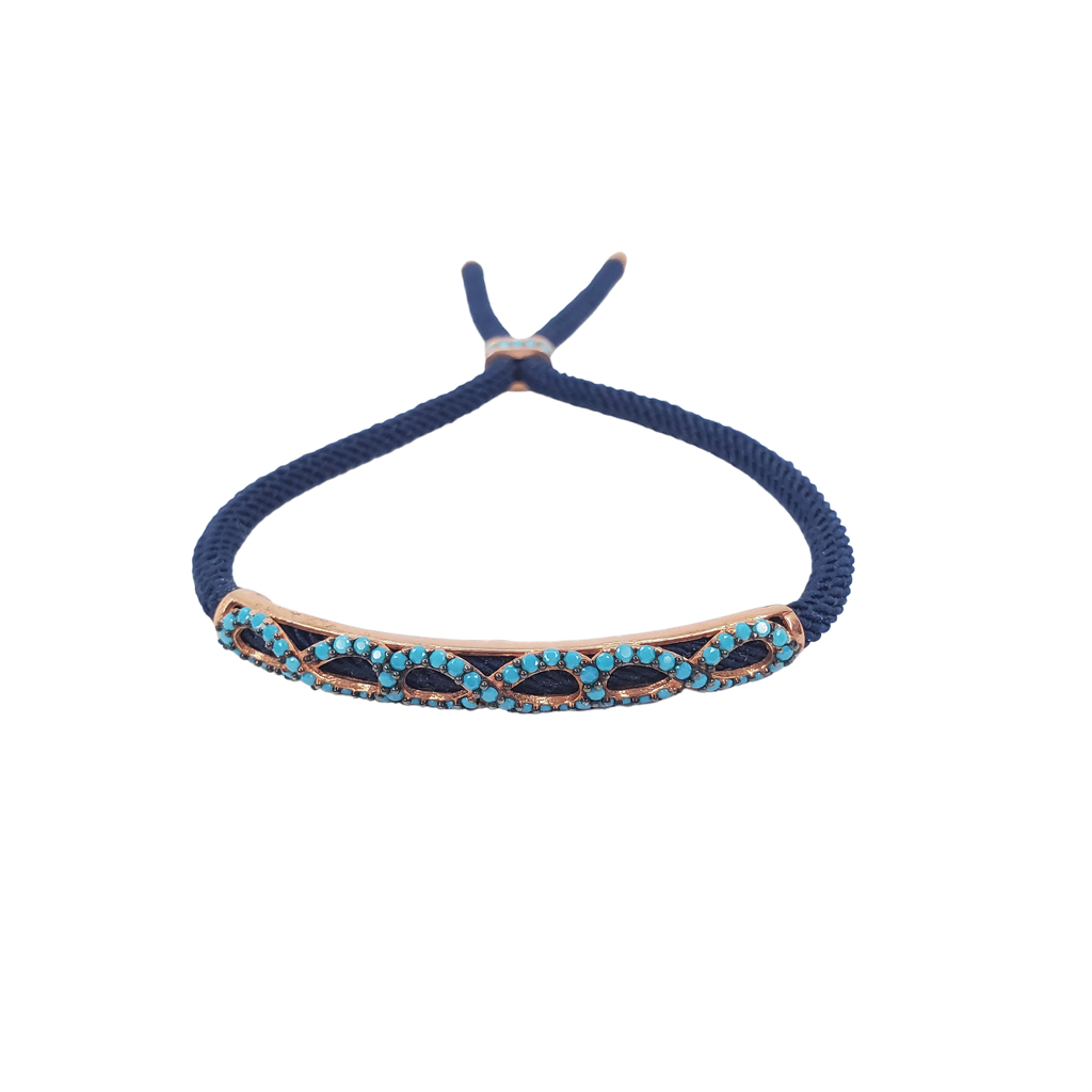 Turquoise zirconia, rose gold bracelet with infinity shape on a navy blue cord, front look.