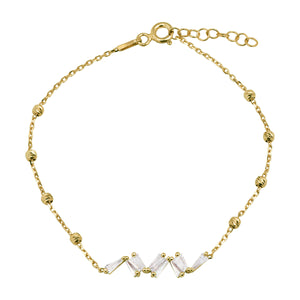 925 Sterling silver, gold plated bracelet with dorica beads and white zirconia stones.