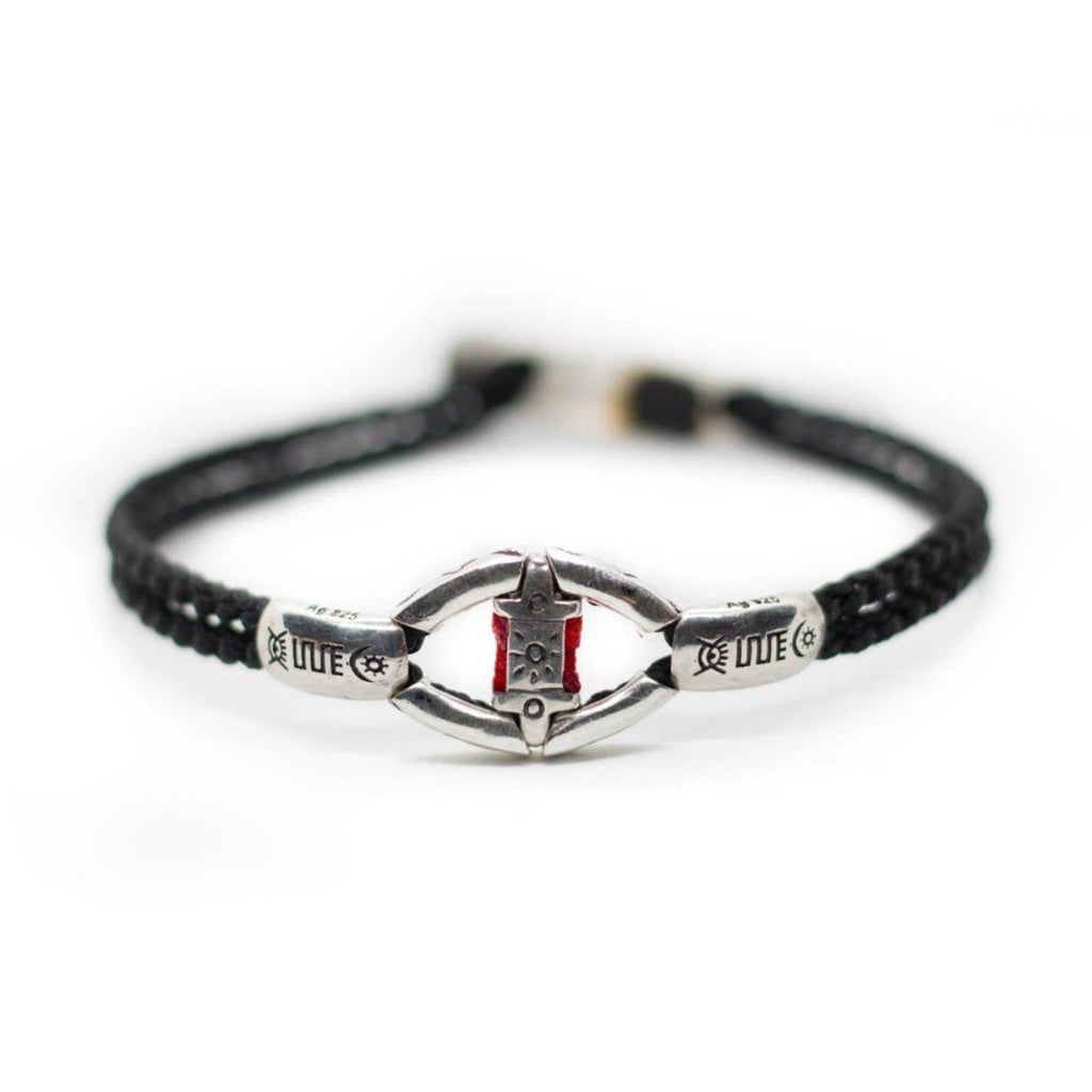 Custom design silver bracelet with a symbol called devotion with hand braided black string,