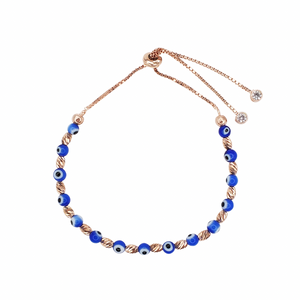 Rose gold bracelet with blue evil eye beads.