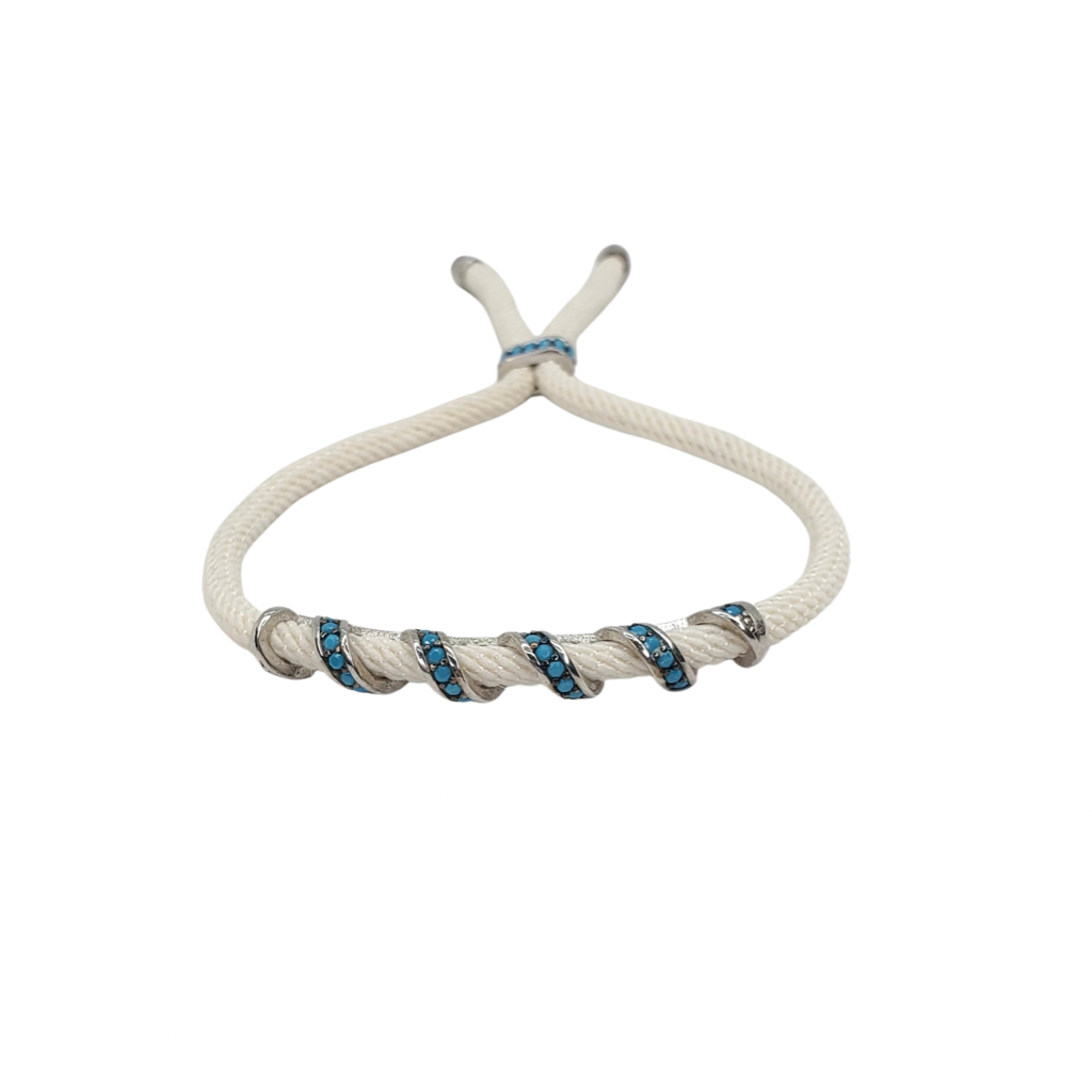 Turquoise zirconia, silver bracelet on a beige cord, front look.