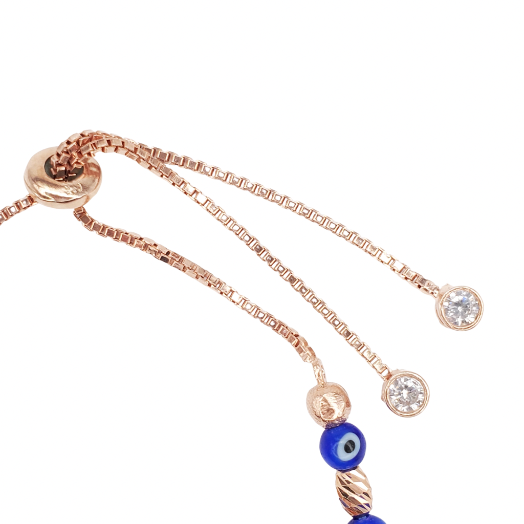 Rose gold evil eye bracelet detail look to ending clasp.