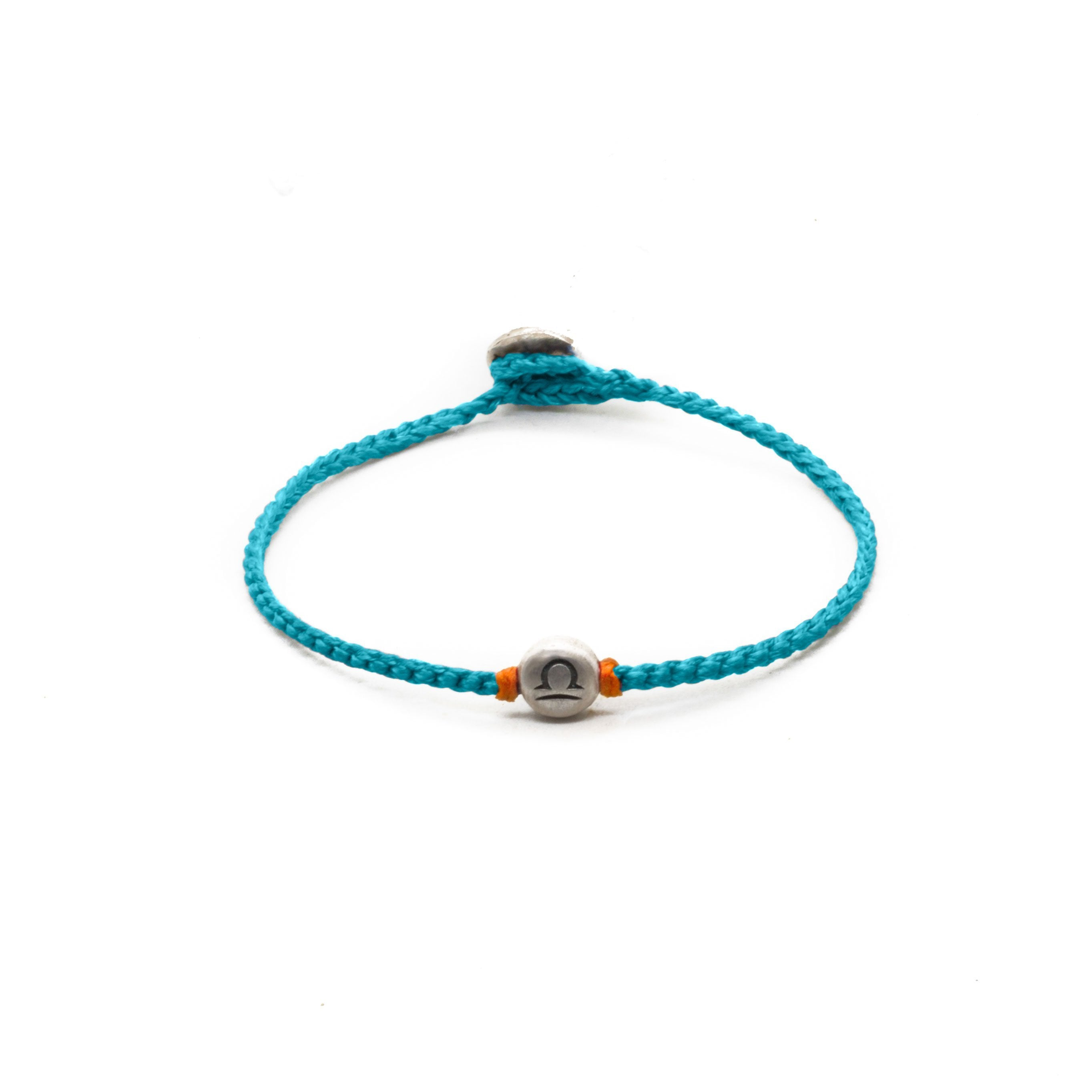 Silver Libra zodiac sign bracelet with turquoise  hand braided chain.
