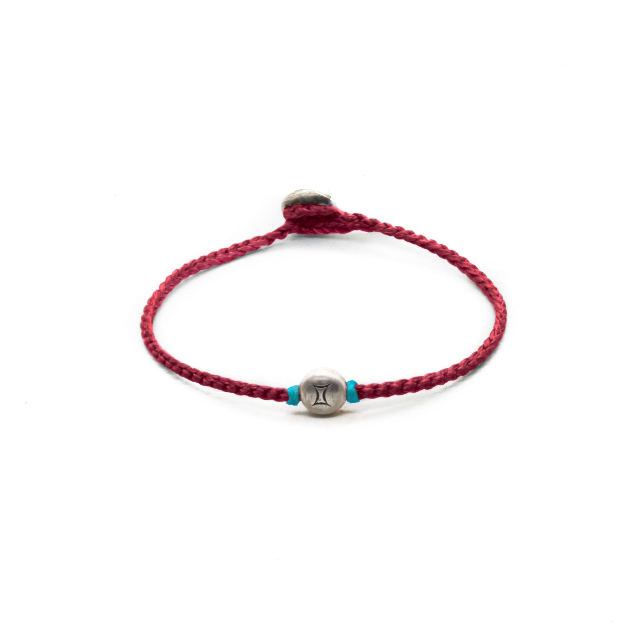Silver Gemini zodiac sign bracelet with red hand braided chain.