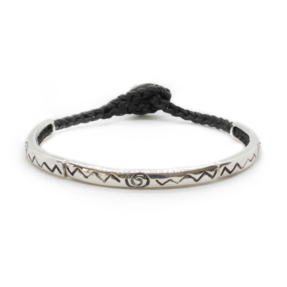 Custom design bracelet with three silver sticks with soul sign,  on black hand braided string.