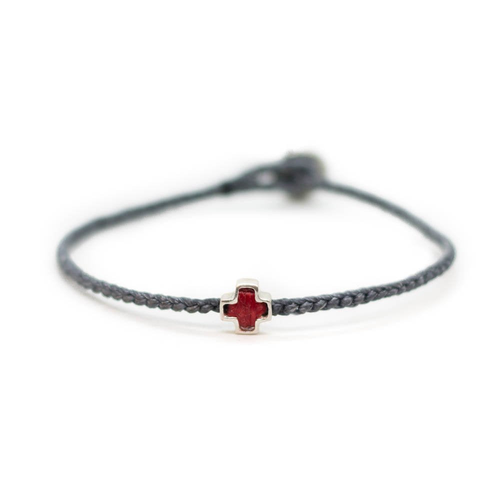 Fifth bracelet with braided string and silver cross symbol