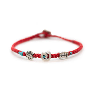 Soul bracelet with red braided string