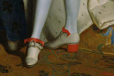man wearing high-heel shoes