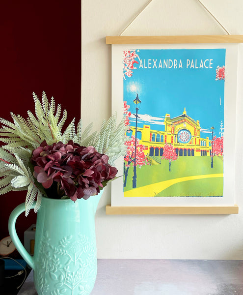Alexandra Palace Art Print hanging magnetic frame with flowers
