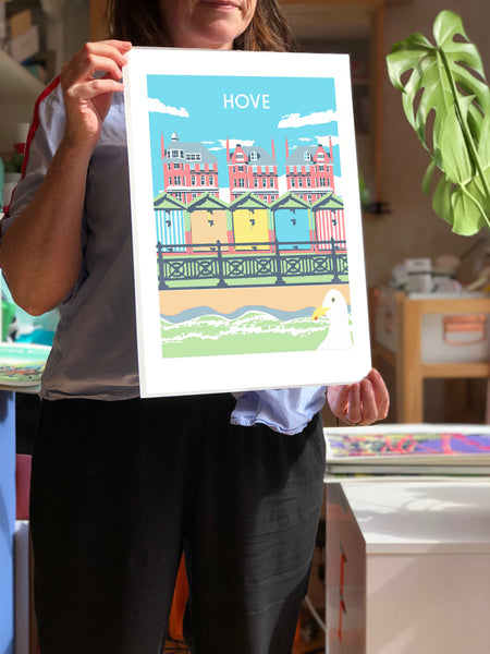 Hove Art Print, artist hold unframed print, by Red Faces Prints