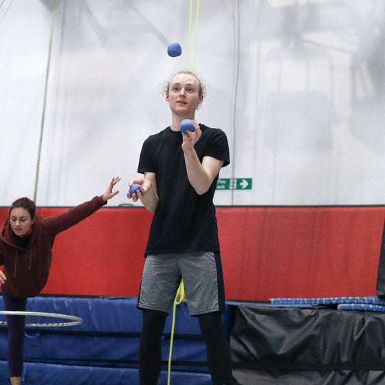 Juggling student juggles three balls