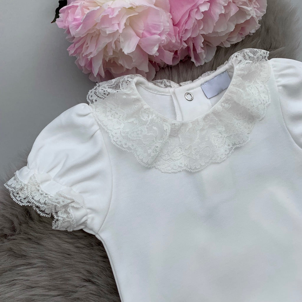 Close up of portuguese baby frill collar bodysuit in ivory with lace collar