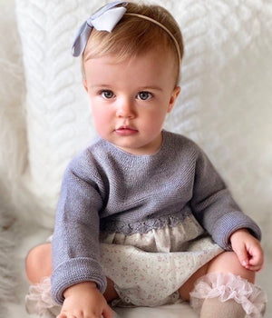 baby girl wearing grey Wedoble baby romper, made in portugal