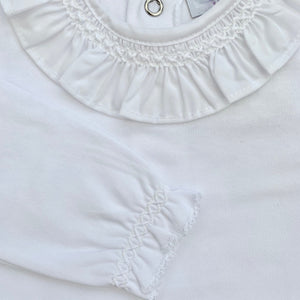 Close up of white frill collar X stitch body suit.  Made in Portugal by laivicar