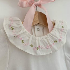 classic baby bodysuit with embroidered frill collar, made in portugal