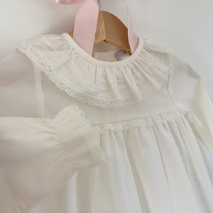 close up of ivory frill collar classic baby blouse, made in portugal