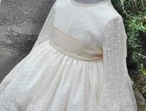close up of cream lace christening gown hand made in Spain by sonata
