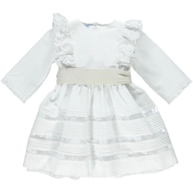 From view of white flower girl dress with lace panels and beige waistband with lace panels