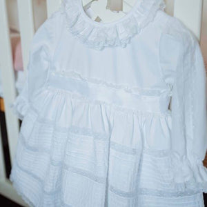White ceremony dress with lace panels and frill collar. made in Portugal