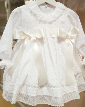White plumeti christening dress with lace collar and 2 large satin bows