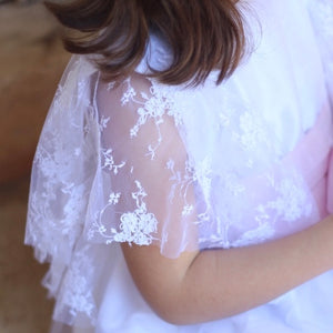 close up of lace fluted sleeves on white dress. hand made in Portugal