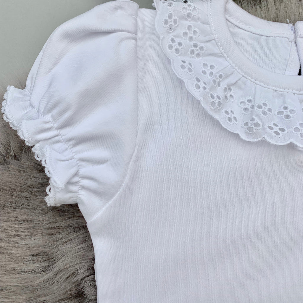 close up of broderie frill  collar bodysuit in white with short sleeves. made in portugal