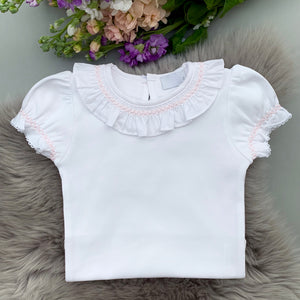 white frill collar bodysuit with pink smocking, made in portugal