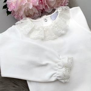 close up of Portuguese baby bodysuit with long sleeves in ivory with full lace collar