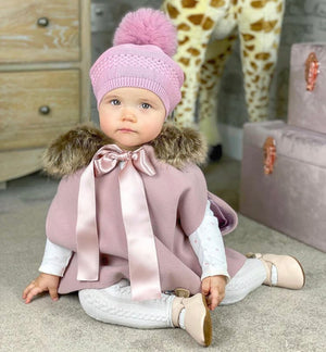 baby wearing dusty pink cape & wedoble leggings