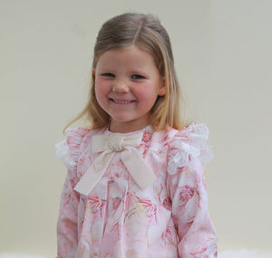 girl wearing pink floral baby dress